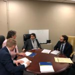 Six people sit around a round table in Sen. Comerford's State House office