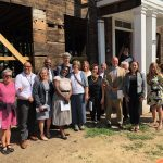 Sixteen people touring the site of Sergeant House currently under construction